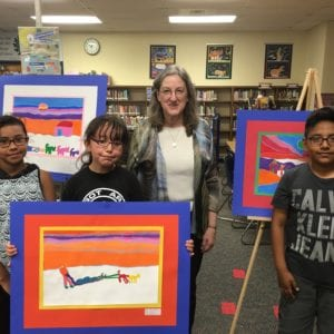 Young artists of Graham Elementary School in Austin, Texas, beside their winning artwork, inspired by Diamond Willow
